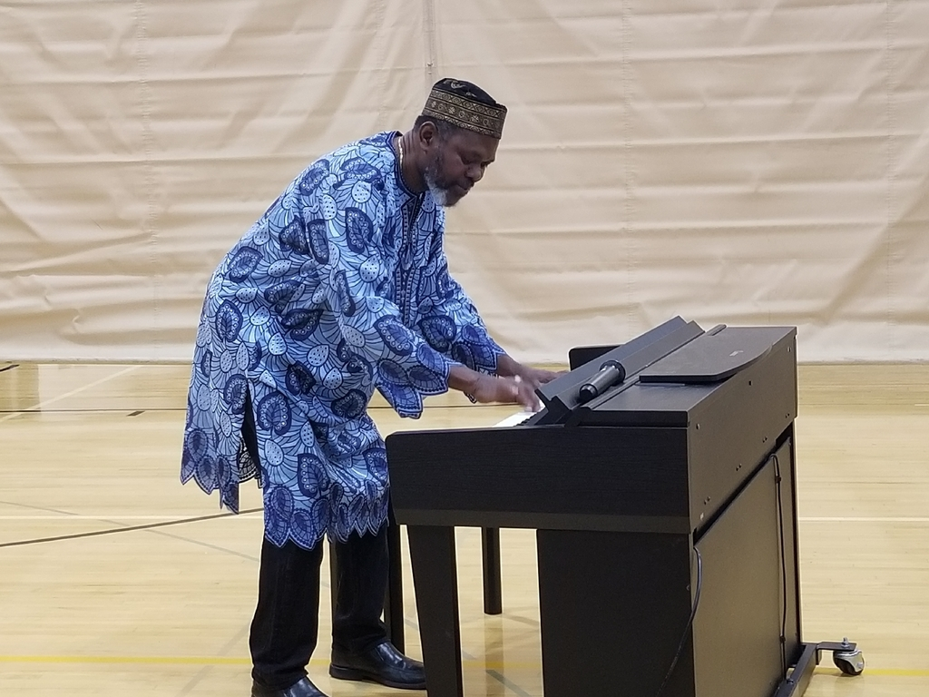 Sowah playing piano