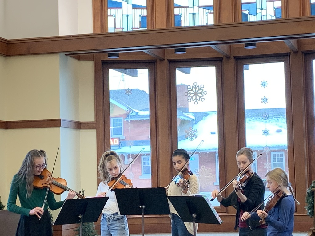 Strings Club performing holiday music